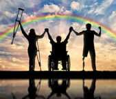 Disabled people holding hands on rainbow background reflection in water