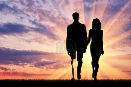 Photo for Concept of rehabilitation of invalids with prosthetic legs. Walking a disabled man with a woman - Royalty Free Image