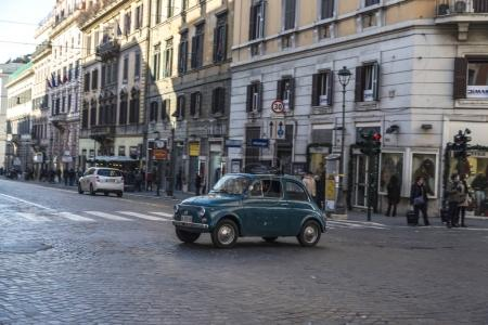 Fiat 500 driving in Rome