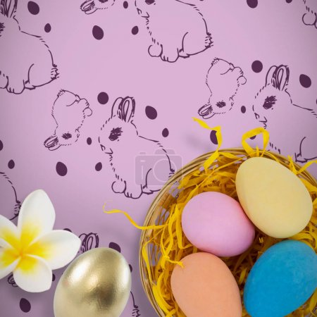 Colorful easter eggs in wicker basket nest