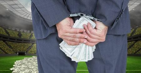 businessman with handcuffs and money