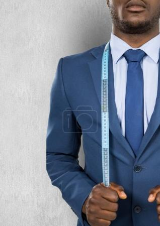 businessman with measuring tape