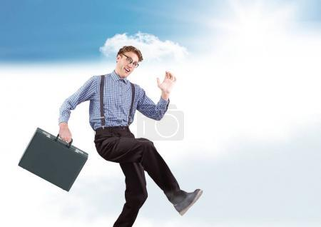 Businessman with briefcase in clouds