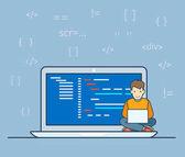 Programmer sitting on big laptop