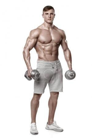 Photo for Sexy athletic man showing muscular body with dumbbells, full length, isolated over white background. Strong male naked torso abs - Royalty Free Image