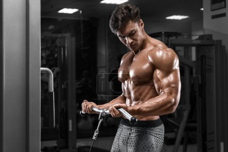 Photo for Muscular man working out in gym doing exercises for biceps, strong male naked torso abs - Royalty Free Image