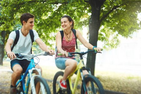Young people, couple with bicycles in the park
