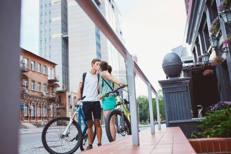 Young people, couple with bicycles on the street