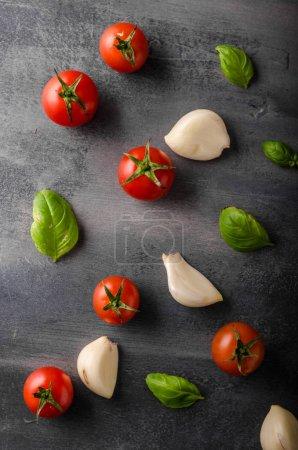 Tomato garlic basil background