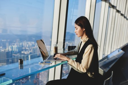 Woman successful freelancer is using laptop computer to make money on the Internet