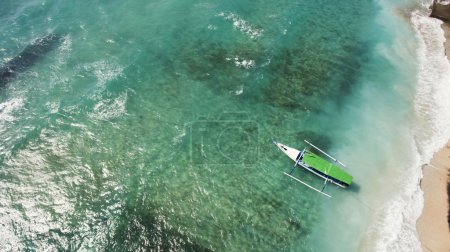 Top view aerial photo from drone of a Long-tailed boat getting ready for snorkeling day in Thailand.