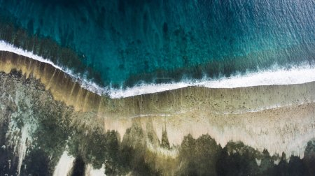 Top view aerial photo from flying drone of an amazingly beautiful sea with turquoise water and calm waves.