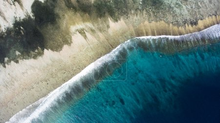 Top view aerial photo from flying drone of a wonderful nature landscape of Indian Ocean with coral bottom perfect place for snorkeling with masks.