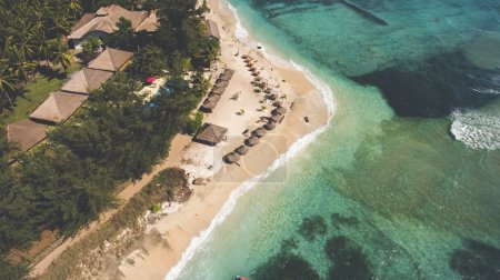 Top view aerial photo from flying drone of a beautiful view on a Asian island with luxury hotels and rental villas near sea with amazing landscape