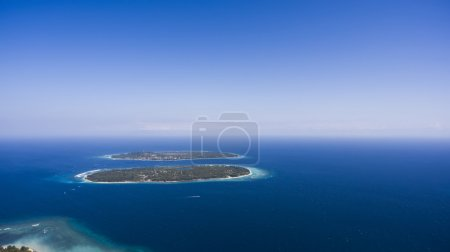 Aerial photo from airplane of a wonderful nice landscape with archipelago small islands in open Indian ocean for a romantic vacations, family trip, or an all-inclusive holiday