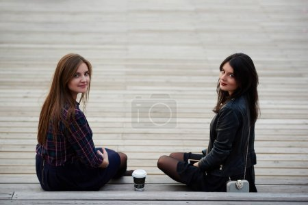 Two female student are posing