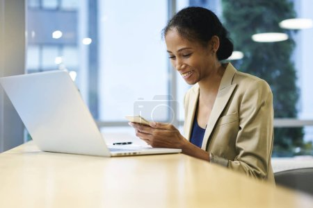 Attractive afro american female manager having fun during work break in office