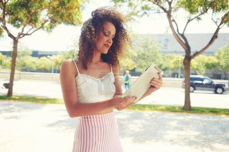 Female tourist using navigation   maps on digital tablet apps