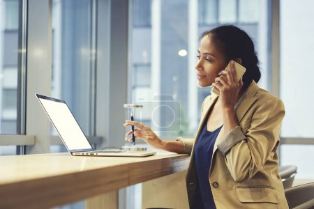 Businesswoman  using laptop computer with mock up screen and wifi connection