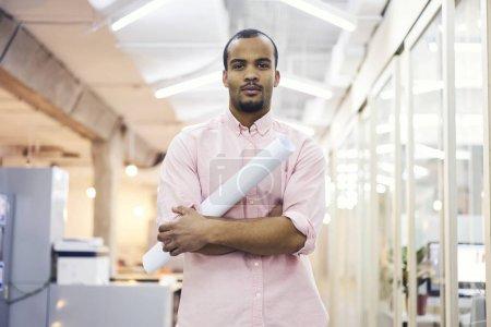 Portrait of skillful male office worker of design studio