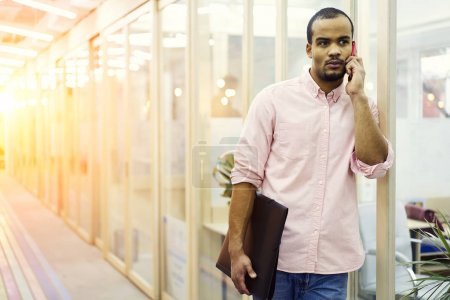 Mindful portrait of young freelancer employee listening attentively to customer's requirements for remote job