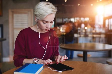 Female hipster making online shopping