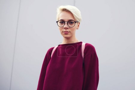 Female hipster standing with board
