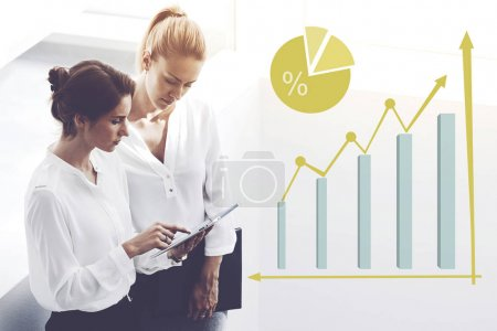 Female employees monitoring financial income