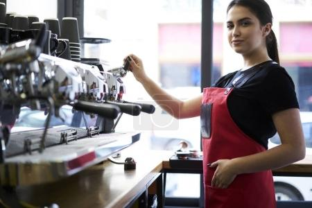 Portrait of charming waitress standing on workplace ready to make ordering enjoying her job