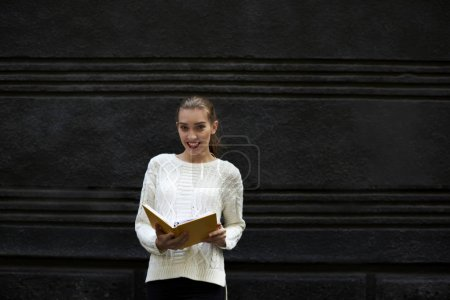 Casual dressed female reader posing for camera