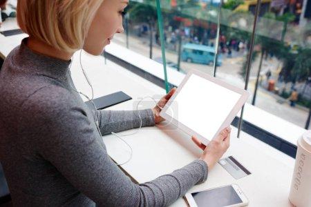 Hipster girl enjoying leisure in coffee shop listening music