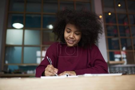 Talented blogger creating article noting ideas with pen