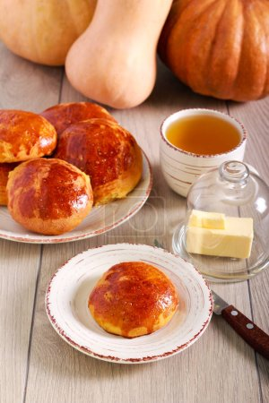 Photo for Pumpkin buns served on plate over table - Royalty Free Image