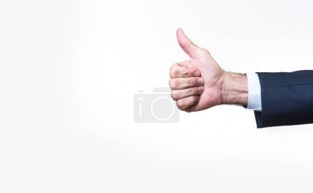 Photo for Senior business mans hand giving a thumb up, isolated on white - Royalty Free Image