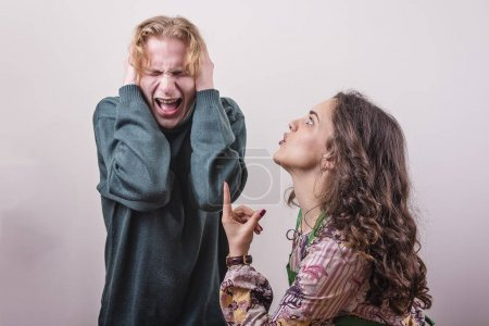 Photo for Married couple issues, young wife yelling at her husband, husband feeling abused and cant listen to her - Royalty Free Image