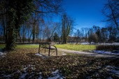 Lonely bench in the park in early springtime