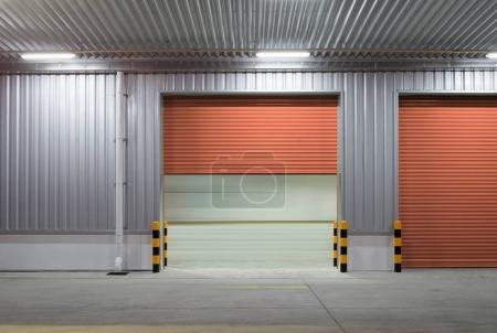 Photo for Shutter door or roller door and concrete floor outside factory building use for industrial background. - Royalty Free Image