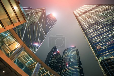 Photo for Perspective view of building in downtown hong kong city with light  at night time. - Royalty Free Image