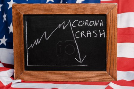 Photo for Corona crash lettering written on chalkboard on american flag background, coronavirus concept - Royalty Free Image