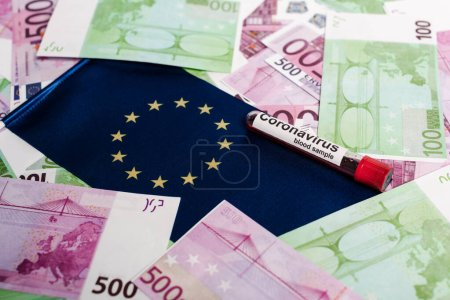 Photo for Euro banknotes, European flag and coronavirus blood sample - Royalty Free Image