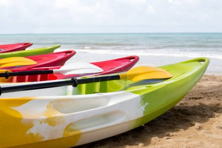 Colorful sea kayaks on sand beach