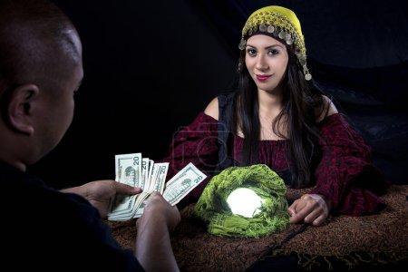 Female fortune teller or con artist swindling mone...