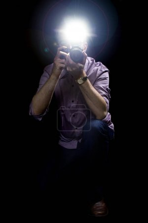 Paparazzi with Camera and Flash in a Dark Background