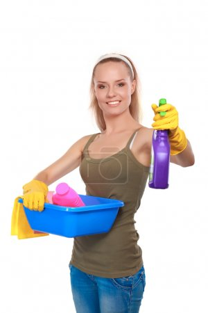 Cheerful woman is cleaning something with wisp and...