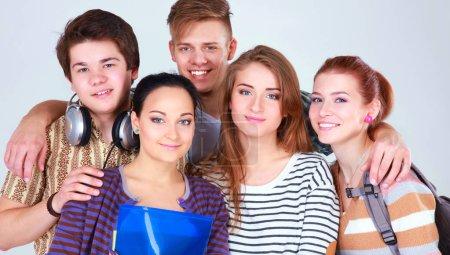 Happy group of students holding notebooks , isolat...
