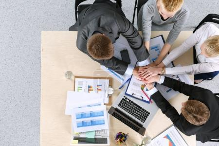 Business team with hands together - teamwork concepts, isolated. Business team