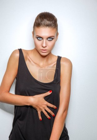 Portrait of a beautiful woman with necklace, isolated on white background. Portrait of a beautiful woman.