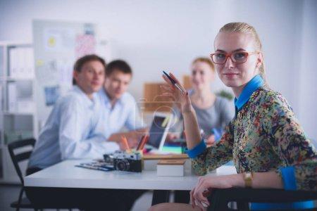 Portrait of attractive female designer in office. Female designer