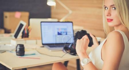 Photo for Young photographer and graphic designer at work. - Royalty Free Image