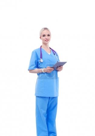 Photo for Female doctor using a digital tablet and standing on white background. Woman doctors - Royalty Free Image
